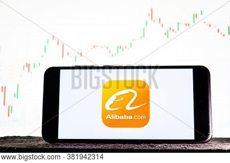 Tula, Russia - August 10, 2020: Logo Alibaba On A Smartphone Against The Background Of Stock Market