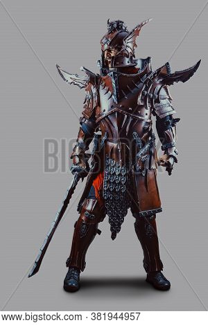 Powerful Knight In Armor With The Sword. Isolated Over Grey Background.