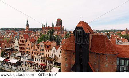 Gdansk, Poland 09.15.2019 Crane - Motlawa River - St Marys Church Behind. Aerial Photo