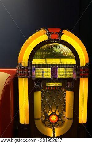 Oklahoma Usa - September 10 2015; Brightly Illuminated Jukebox On Dark Background