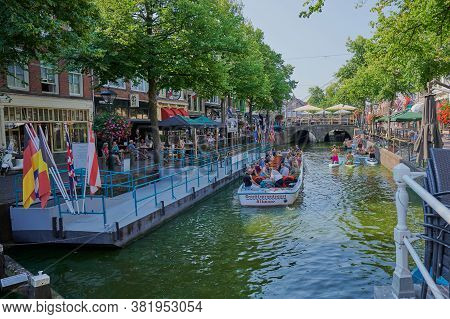 Alkmaar, Netherlands - August 12, 2020: Canal In The City Of Alkmaar, Netherlands, An Excursion Boat