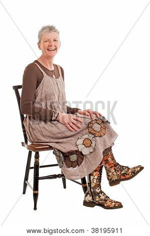 Laughing Older Woman In Flowered Boots Sits Sideways