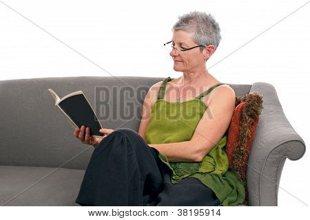 Senior Woman Sits And Reads A Book