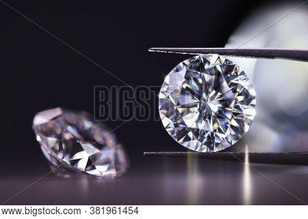 Diamond In Tweezers. Precious Luxury Gemstone In Tweezers