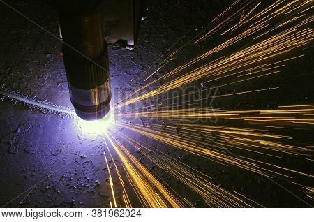The Process Of Cutting Metal Using Plasma Cutting.