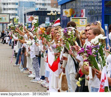 Minsk, Belarus - August 22, 2020. People Holding Flowers During Peaceful Protests. Minsk, Belarus. P