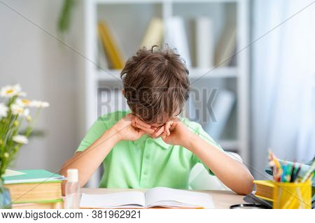Tired Schoolboy Cries, Rubs His Eyes, Because He No Longer Wants To Read Or Suffers From Bullying. H
