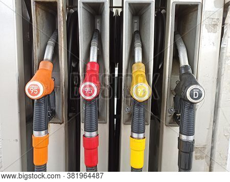 Moscow, Russia. August 2020. Various Colored Refueling Pistols Or Fuel Guns In Fuel Column On Fuel S