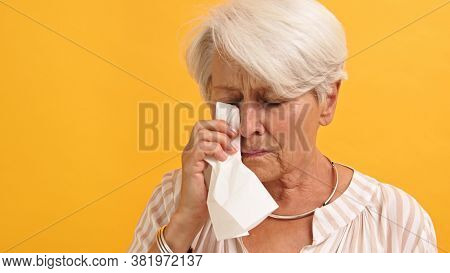 Portrait Of Lonely Sad Vulnerable Old Woman Wiping Her Tears. High Quality Photo