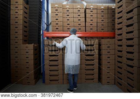 Male Worker Working In A Hypermarket Warehouse