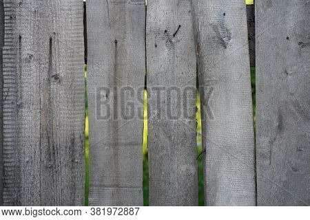 Background Of Flaky Wood. Backdrop Of Wooden Panels With Aged Surface