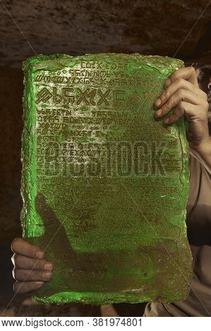 Detail Of Mysterious Artifact Emerald Tablet Found By Adventurer In Cave