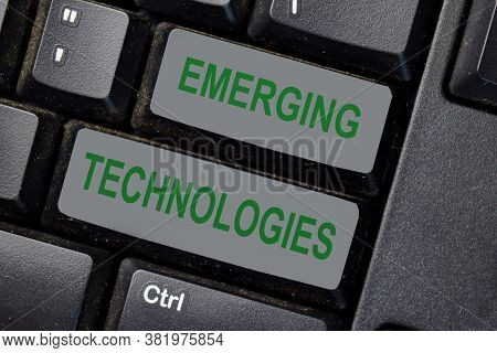 Emerging Technologies Text Write On Keyboard Isolated On Laptop Background