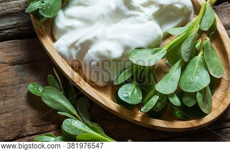 Fresh Purslane (portulaca Oleracea), Edible Weeds With Yoghurt On Rustic Table. Vegetable Containing