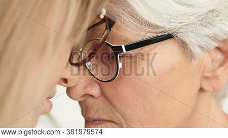 Sentimental Forehead Touch Of Young And Senior Woman. Close Up. High Quality Photo