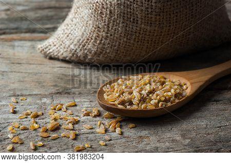 Dry Bulgur Wheat Grains In Wooden Scoop Or Shovel, Rustic Style. Heap Of Uncooked Siyez (black) Bulg