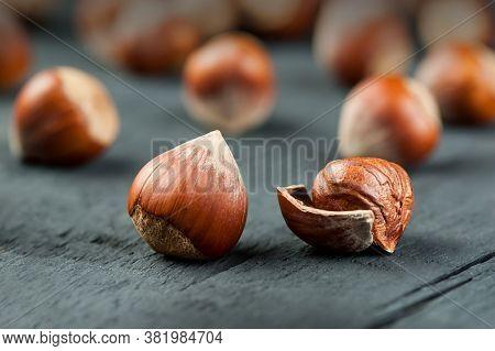 Hazelnuts, Filbert On Wooden Table. Heap Or Stack Of Hazel Nuts. Hazelnut Background, Healty Food