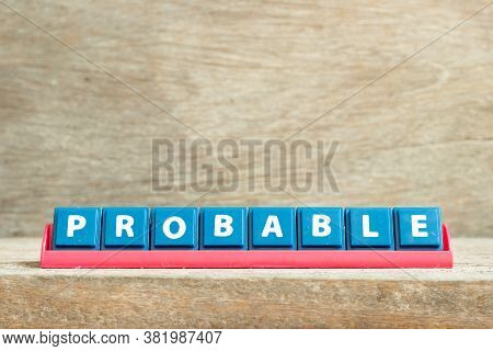 Tile Letter On Red Rack In Word Probable On Wood Background