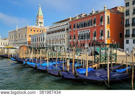 Gondolas Moored Near Piazza San Marco In Venice, Italy. Venice Is Situated Across A Group Of 117 Sma