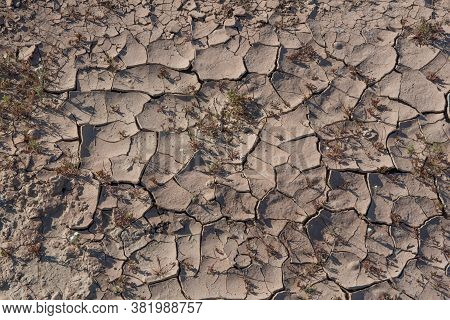 Cracked, Barren Soil To Illustrate In The Sonoran Desert Of Southern California, Showing That There