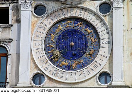 Detail Of The Clock Tower On Piazza Di San Marco In Venice, Italy. The Clock Was Designed By Zuan Pa