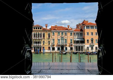 View Of Grand Canal Framed By A Building Window In Venice, Italy. Venice Is Situated Across A Group