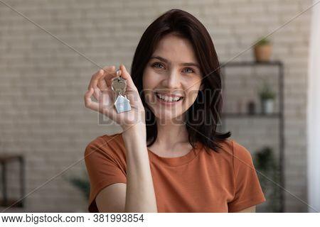Portrait Of Happy Female Tenant Show House Keys