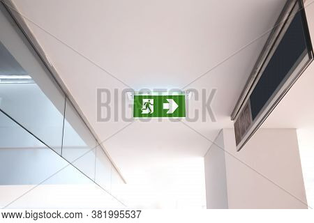 Green Emergency Fire Exit Sign Or Fire Escape With The Doorway In The Building Ideas For Evacuation