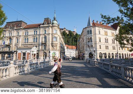 Ljubljana, Slovenia - August 13, 2020: A Man In Slovenian National Costume Crosses The Road In The O