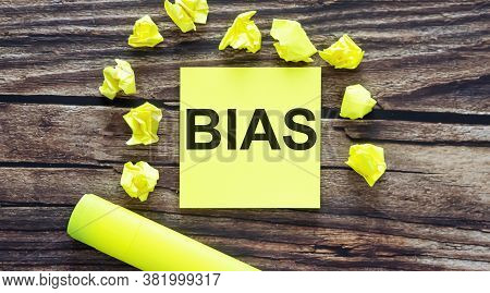 Bias Notes About Bias Concept On Yellow Stickers On Wooden Background