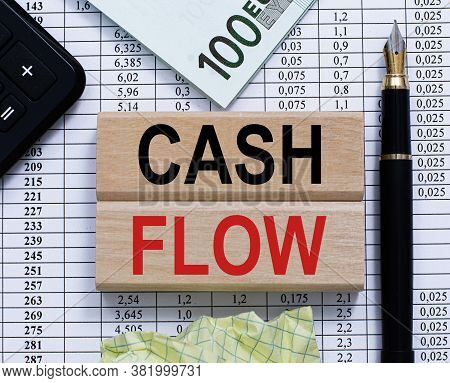 Wooden Planks With Text Cash Flow On Table Background, Pen, Money, Calculayor. Financial, Marketing