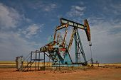 Original Electric Oil Pumper or Oil Jack from the first oil boom in North Dakota. Close to Wiliston, ND. poster