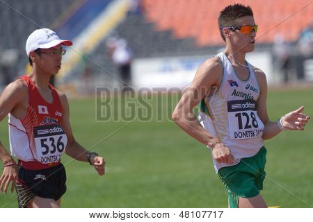 DONETSK, UKRAINE - JULY 13: Toshikazu Yamanishi, Japan (left), and Nathan Brill, Australia, compete in final of 10,000 m Race Walk during World Youth Championships in Donetsk, Ukraine on July 13, 2013