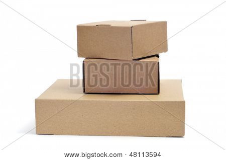 some brown cardboard boxes of different sizes on a white background
