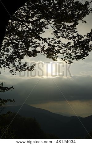 Sunrise Above Stormy Mountain