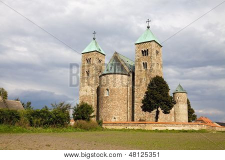 Tum is a village in the central Poland. The Collegiate church of St. Mary and St. Alexius was built during the years 1140-1161. poster