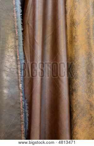 Suspended sample pieces of the brown leatherette poster