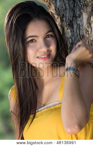 Happy Thai Woman Posing Against A Background Of Trees