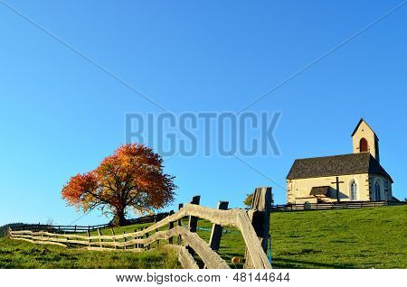 Church And Fence In Autumn