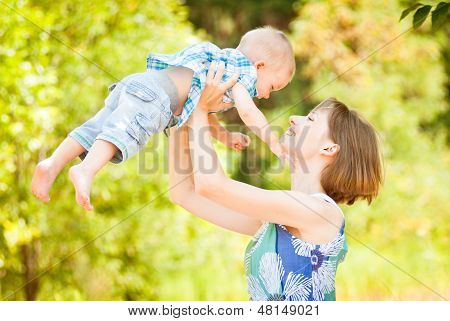 Mom and son playing outdoor together