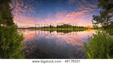 The Oxbow Bend of the Snake River in Wyoming at sunrise poster