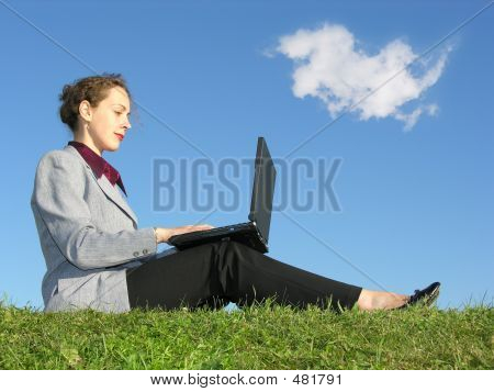 Businesswoman Sit With Notebook On Blue Sky With Cloud