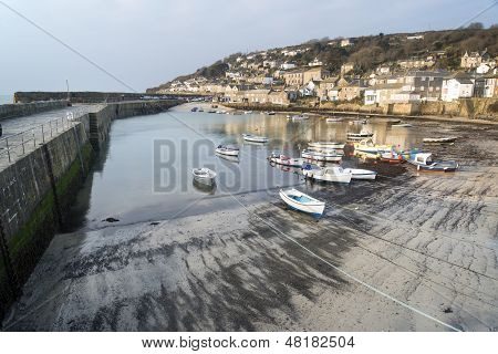 A traditional Cornish fishing village and harbor Cornwall England