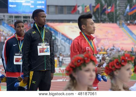 DONETSK, UKRAINE - JULY 13: Medal ceremony in 110 m hurdles during 8th IAAF World Youth Championships in Donetsk, Ukraine on July 13, 2013. Left to right: Humphrey, USA, Hyde, Jamaica, Lu, China