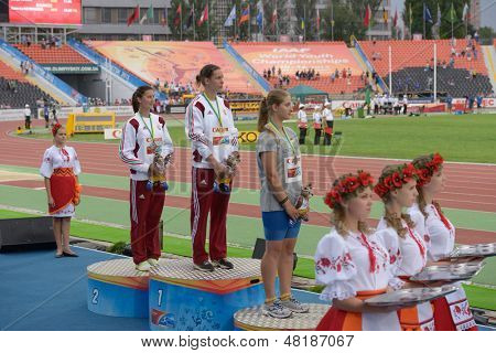 DONETSK, UKRAINE - JULY 13: Medalists in the hammer throw on the medal ceremony during 8th IAAF World Youth Championships in Donetsk, Ukraine on July 13, 2013