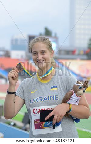 DONETSK, UKRAINE - JULY 13: Valeriia Semenkova of Ukraine with her bronze medal in hamer throw on the medal ceremony during 8th IAAF World Youth Championships in Donetsk, Ukraine on July 13, 2013