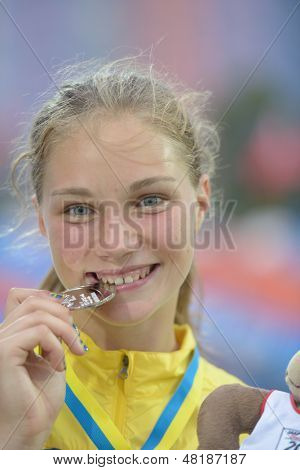 DONETSK, UKRAINE - JULY 13: Emma Stenlof of Sweden bite her silver medal in Heptathlon girls on medal ceremony during 8th IAAF World Youth Championships in Donetsk, Ukraine on July 13, 2013