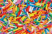 """Background of Multi Colored Sprinkles """"Jimmies"""" closeup poster"""