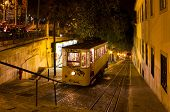 A night shot of the famous tourist attraction in Lisbon the Gloria funicular transportation connecting from Baixa to Bairro Alto. poster