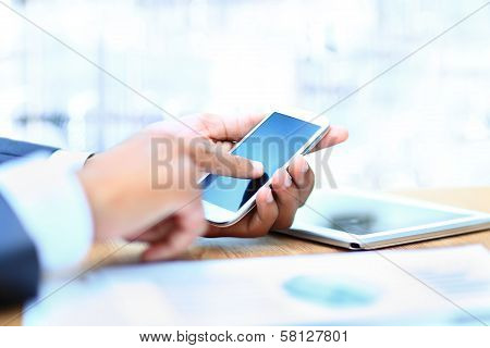 Young businessman working with modern devices digital tablet computer and mobile phone.